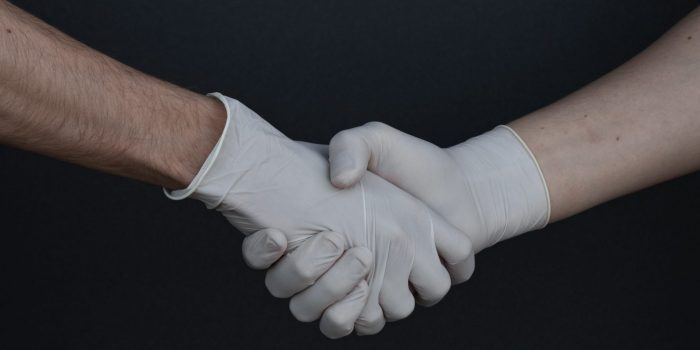 people-shaking-hands-in-latex-gloves-3959482